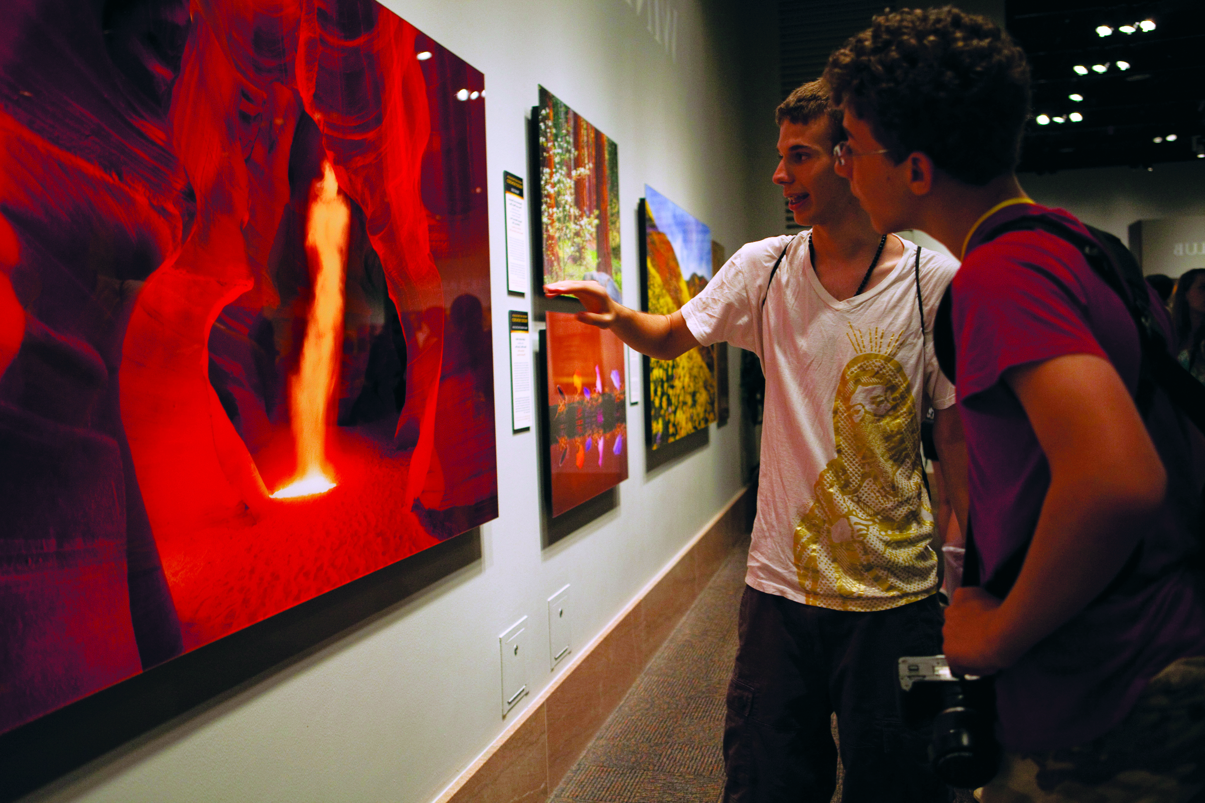 Students analyzing a photograph at an art museum