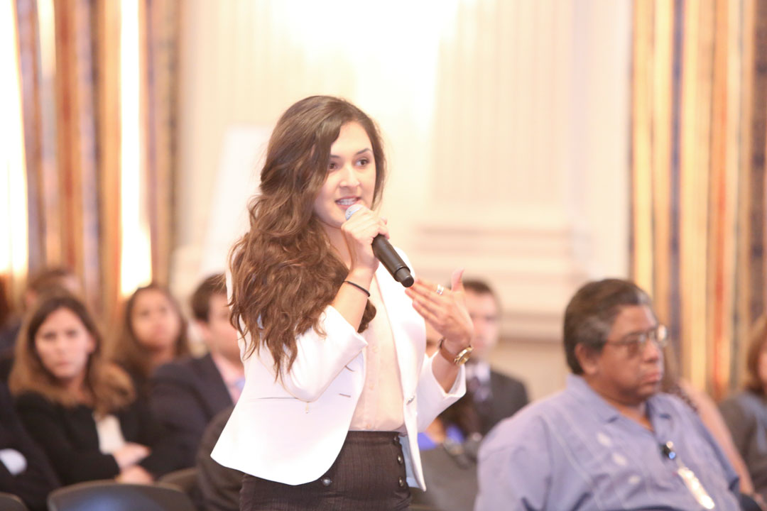 An international student at a conference asking a question