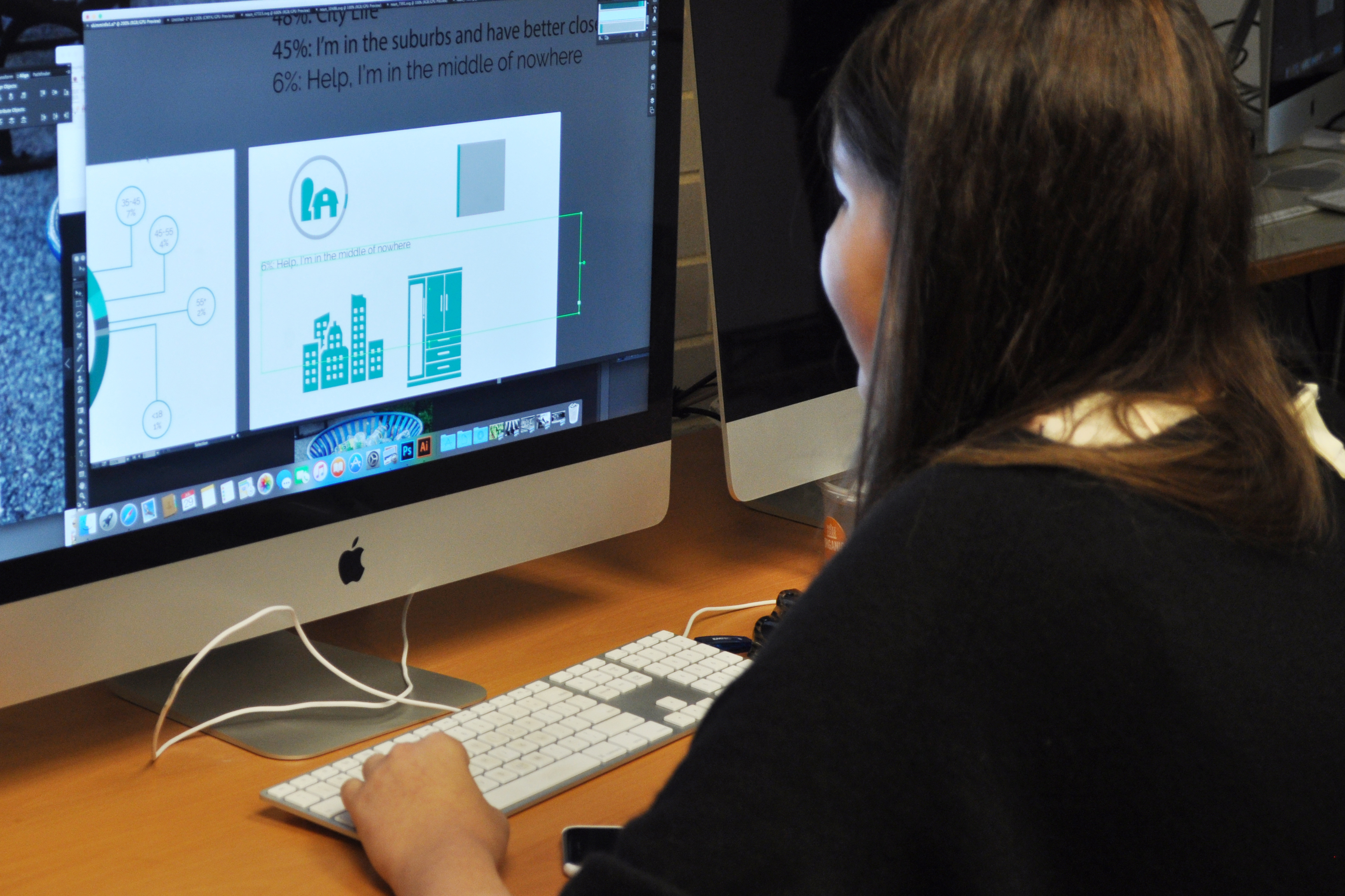 Photo of student doing graphic design work on a Mac