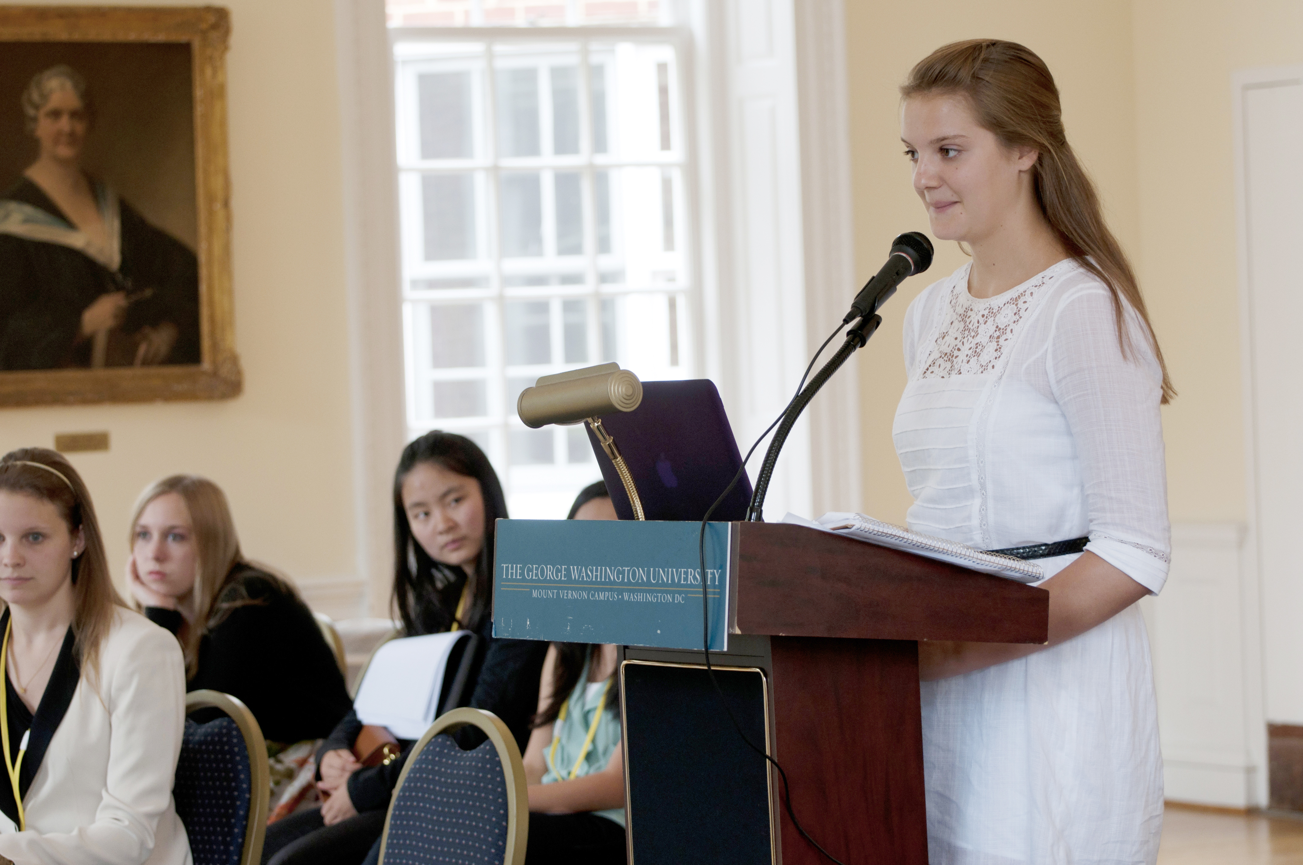 Young female student participating in a mock trial