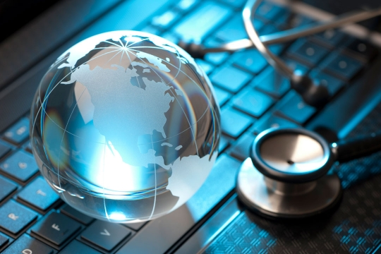 Image of a keyboard with a world and stethoscope on it