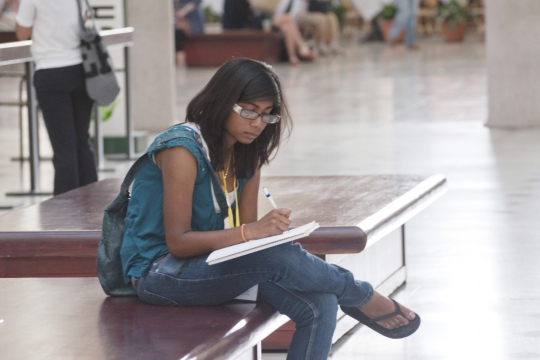 Student writing in Union Station