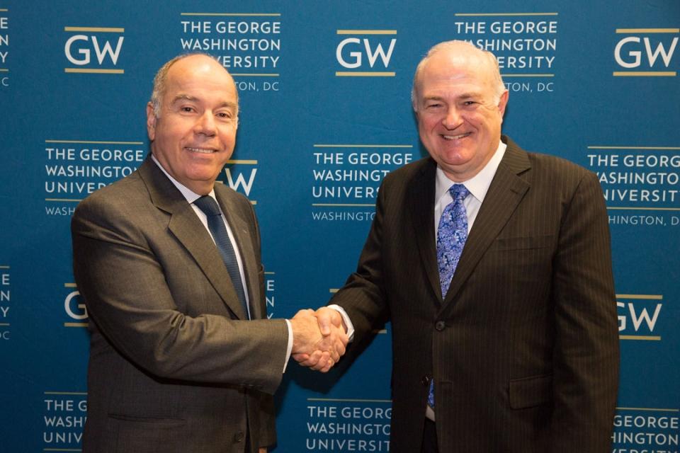 The Brazilian Ambassador & President Knapp shaking hands