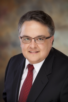 Headshot of John Avellanet