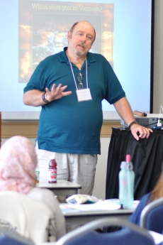 Photo of Paul Tschudi teaching at the Summer Grief Institute