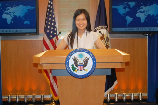 Photo of student at the State Department podium