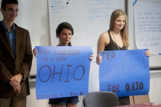 Photo of students holding campaign signs