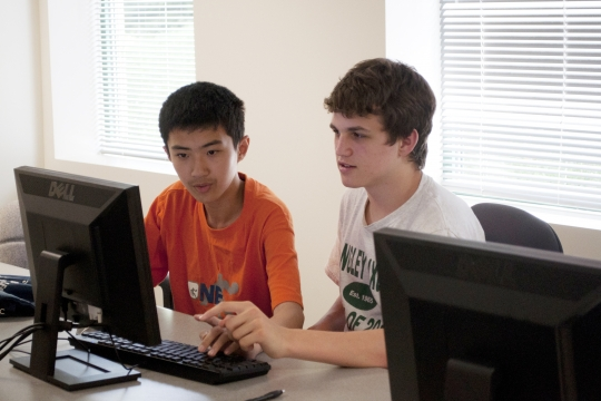 Two Pre-College students at a computer