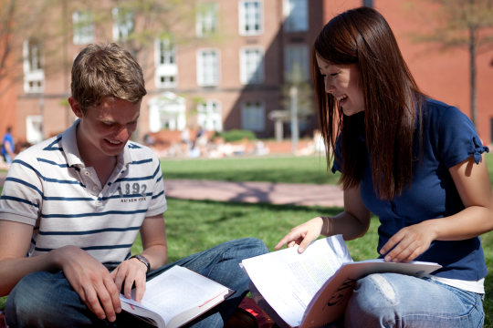 International students studying outside on GW campus